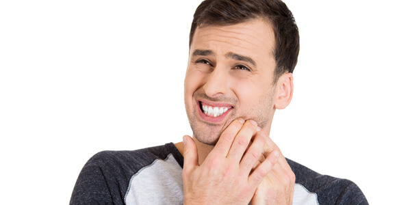 Young guy with tooth ache
