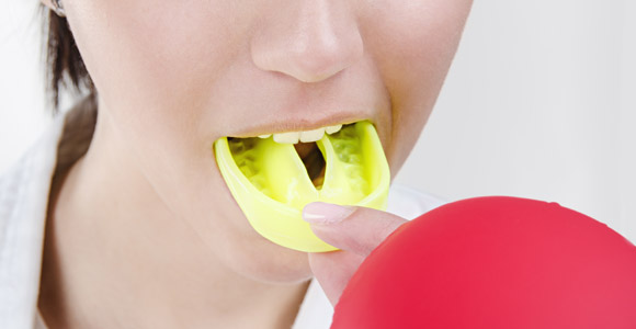 Woman with mouthguard